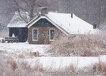 Postcard farm in the snow