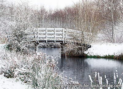Postcard bridge in winter landscape